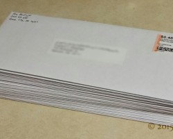A small stack of QSL cards ready for sending.